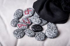 Runes of natural stones  on velvet bag Royalty Free Stock Images