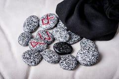 Runes of natural stones  on velvet bag Royalty Free Stock Images