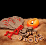 Runes, pouch and candle with copy space Royalty Free Stock Photo