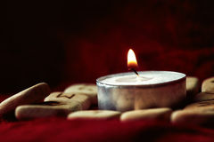 Runes with pouch and candle Stock Images