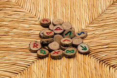 Runes on rattan surface Royalty Free Stock Photography