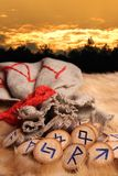 Runes at sunset. Runes and pouch at sunset Royalty Free Stock Photo