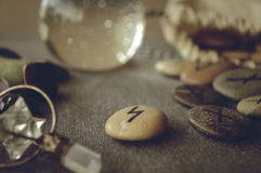 Runes and tarot cards. Divination and prediction on runes and Tarot, mysticism or esoteric isolated on grey background Royalty Free Stock Photography