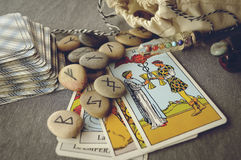 Runes and tarot cards. Divination and prediction on runes and Tarot, mysticism or esoteric isolated on grey background Stock Image