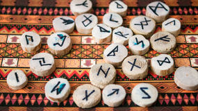 Runes. Wooden runes black magic on a colorful background Royalty Free Stock Images