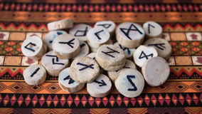 Runes. Wooden runes black magic on a colorful background Stock Photo