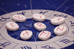 Runes with zodiac stock photography