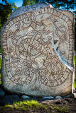 Runestone outside Stockholm. An ancient runestone in Kista outside Stockholm. The runes on the stone translated to English: Sigviðr had this stone raised in stock photography