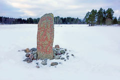 Runestone in a winter landscape royalty free stock photo