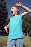 Runing. A boy is runing and yelling royalty free stock photography