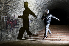Runing. Man runing down the dungeon stairs Stock Photography