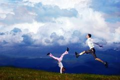 Runing in air. Woman relaxation in air and man jump...a moment of happiness stock images