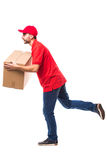 Runing delivery man with box. On white Royalty Free Stock Image