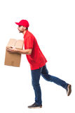 Runing delivery man with box. On white Stock Images