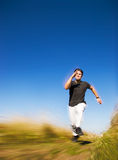 Runing man. Photo with motion blur to raise speed Royalty Free Stock Image