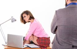 Runing office through a variety of administrative duties. Company owner looking at office secretary. Sexy secretary in. Office wear. Sensual secretary women royalty free stock photo