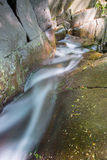 Runing water. Between big rocks Stock Photography
