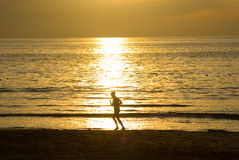 Runing woman at the sunrise Stock Photos