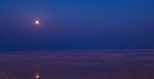 Runn of Kutch aka White Desert in full Moon. This is Runn of Kutch the famous Salt Desert also known as The White Desert, in full Moon light it creates this kind royalty free stock image