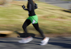 Runner. With motion blur feet Royalty Free Stock Photo