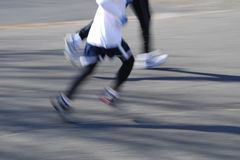 Runner. With motion blur feet stock image