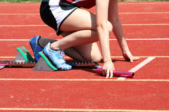 Runner. In the starting blocks with baton royalty free stock image