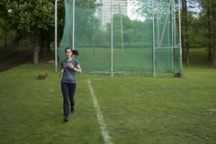 Runner in action. Jogging woman. Sport, fitness, training outdoor Stock Photo