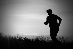 Runner against sky Stock Photography