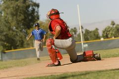 Runner approaching to catcher Stock Images