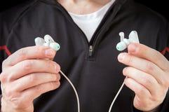 Runner assumes modern waterproof wireless headphones Stock Photography