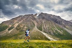 Trail running in the mountains stock photography