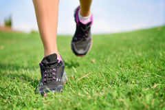 Runner athlete feet running on grass fitness woman Royalty Free Stock Photos