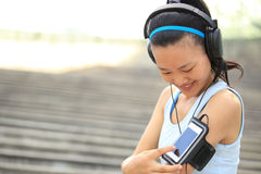 Runner athlete listening to music in headphones fr Royalty Free Stock Images