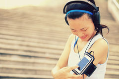 Runner athlete listening to music in headphones fr Royalty Free Stock Image