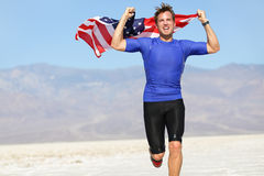 Runner athlete man with the American flag - USA royalty free stock photo