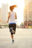 Runner athlete running on city street Stock Photo