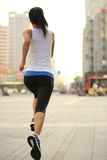 Runner athlete running on city street Stock Images