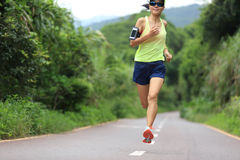 Runner athlete running on forest trail Royalty Free Stock Photography