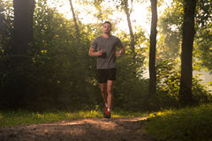 Runner Athlete Running On Forest Trail Royalty Free Stock Photos