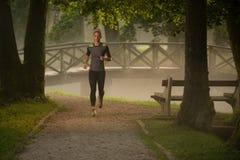 Runner Athlete Running On Forest Trail Stock Images
