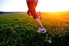 Runner athlete running on grass Royalty Free Stock Photos