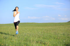 Runner athlete running on grass Royalty Free Stock Images
