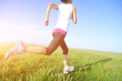 Runner athlete running on grass seaside. Stock Photography
