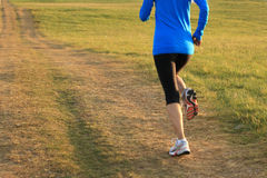 Runner athlete running on grass seaside. Stock Photography