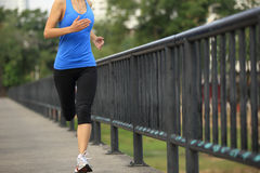 Runner athlete running on iron bridge Stock Images