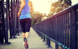 Runner athlete running on iron bridge Royalty Free Stock Image