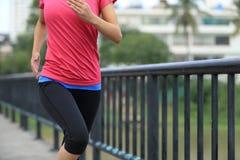 Runner athlete running on iron bridge Stock Image