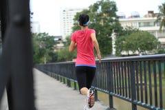 Runner athlete running on iron bridge Royalty Free Stock Photos