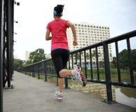 Runner athlete running on iron bridge Royalty Free Stock Photography