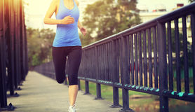 Runner athlete running on iron bridge Stock Image